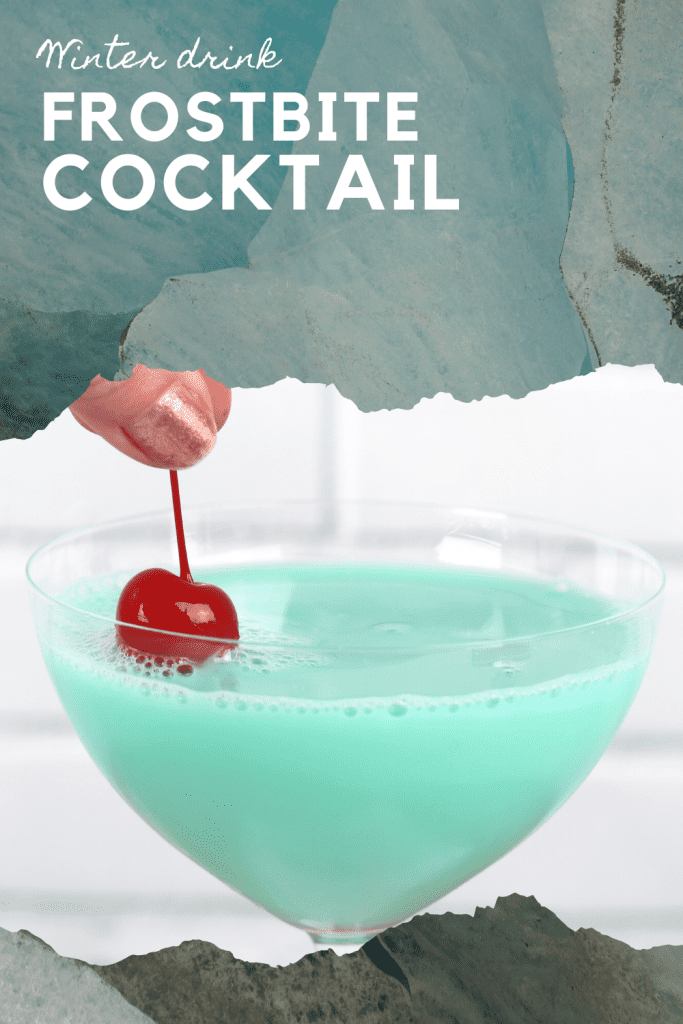 Blue frostbite cocktail with cherry on top